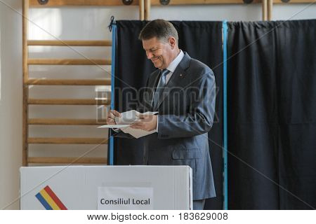 BUCHAREST ROMANIA June 5 2016: The Romanian president Klaus Iohannis votes in the local elections in Bucharest.