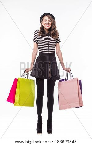 Full Length Shot Of An Attractive Young Woman Holding Color Paper Shopping Bags Isolated On White
