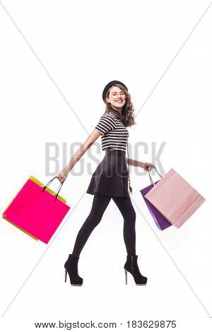 Colourful Shopping Vibes. Full Length Portraits Of Smiling Brunette Woman In Hat With Shopping Bags