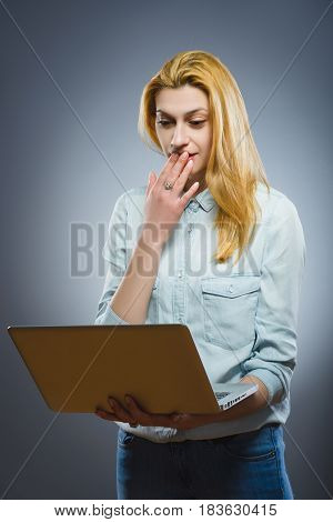 Smart attractive woman looking on laptop. girl searching new information for writing