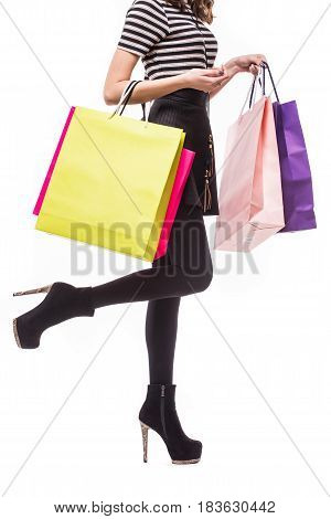 Shopping Woman Holding Shopping Bags. Closeup Of Beautiful Women Colorful Shopping Bags. Isolated On