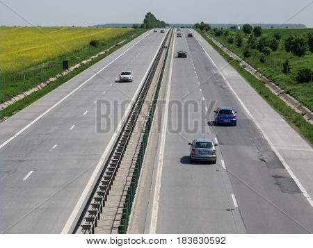 SUN MOTORWAY ROMANIA April 23 2016: Motorway traffic in the daytime on the A2 Motorway also known as the SUN Motorway (Autostrada Soarelui) in Romania.
