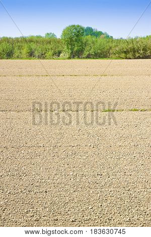 Plough agriculture field before sowing - Plowed field background with copy space