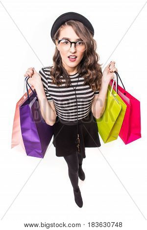 A Top View Of Lovely Woman With Shopping Bags Over White Background