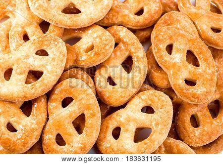 Close up image of cookies called krakelingen as background