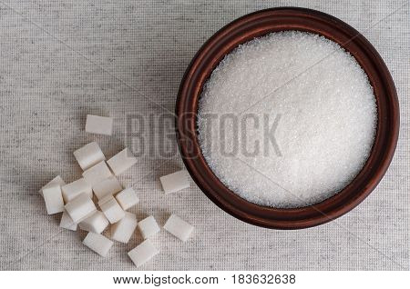 white refined sugar and Bowl of granulated sugar close up top view