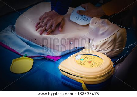 cpr training chest compression dummy basic life support selective focus of AED