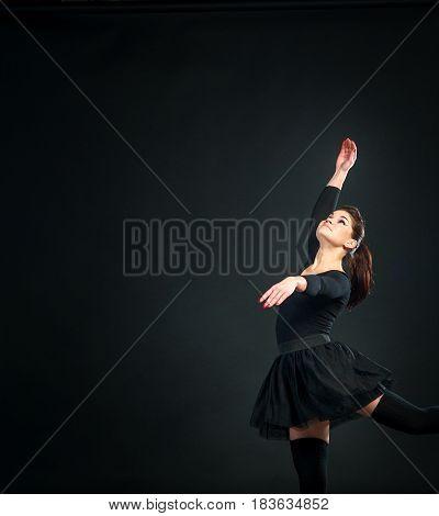 Beautiful Female Ballet Dancer on Black Background