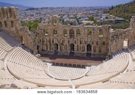 The theatre of Herodes Atticus in Athens. Panorama of the city of Athens in Greece.