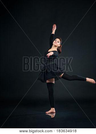 Beautiful woman Ballet Dancer dancing on Black Background