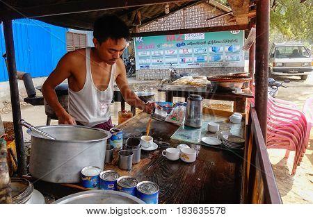 Vendor Cooking Street Food In Mandalay, Myanmar