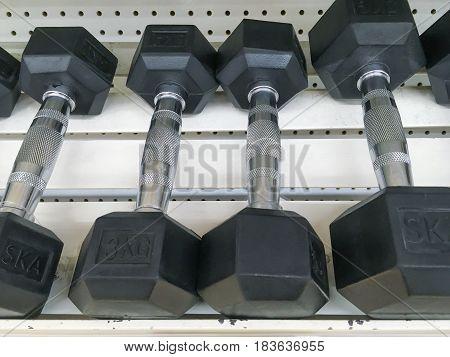 close up Row of Dumbbells on Shop shelf