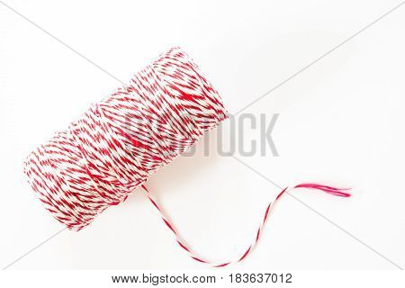Red and white rope reel isolated on white background for wrapping package and post boxes