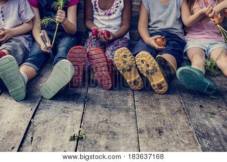 Group of kindergarten kids little farmers learning gardening