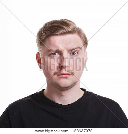 Unpleasant surprise. Negative emotion. Man with disappointed face, grimacing on white studio background, cutout