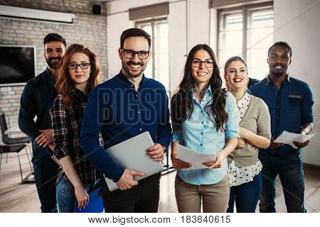 Successful company with happy employees in modern office