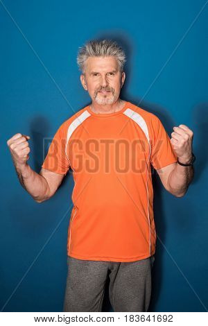 Handsome Mature Sportsman With Clenched Fists Looking At Camera