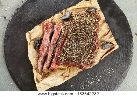 Restaurant Grilled Food - Delicious Grilled Pepper Steak. Gourmet Restaurant Steak Menu. Pepper Steak Served on Parchment