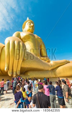 Buddhists In A Queue To The Big Buddha Of Thailand