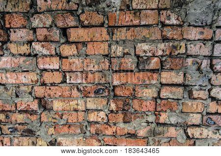 Aged brick wall background texture.Broken cracked  bricks.