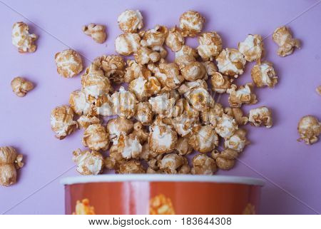 Popcorn In A Paper Cup On A Purple Background,