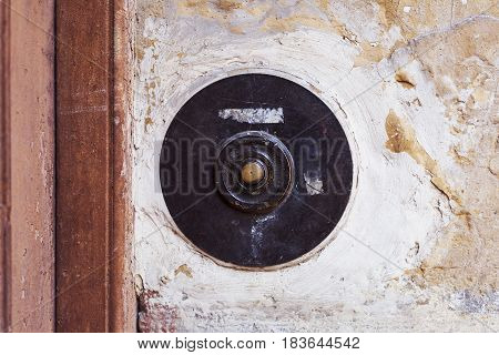 Old Vintage Door Bell Button On Grunge Wall