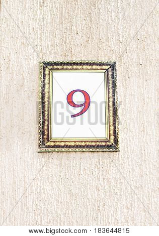 Number nine typed in the beautiful frame on the wall