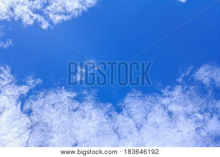 Blue sky background with white clouds. The vast blue sky and clouds sky on sunny day.