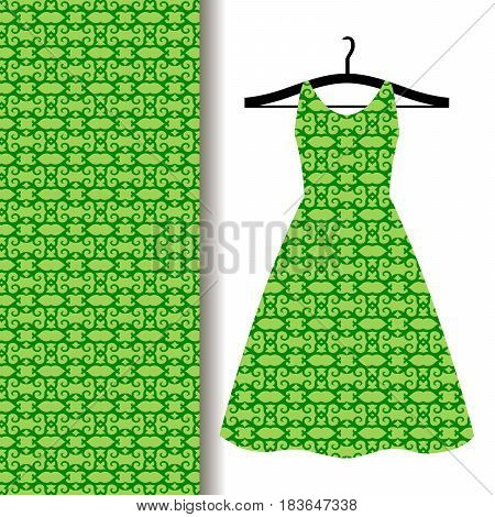 Women dress fabric pattern design on a hanger with green traditional arabic pattern. Vector illustration