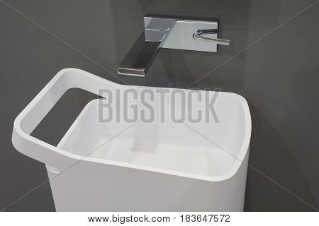 White top washbasin glossy metal mixer on gray background