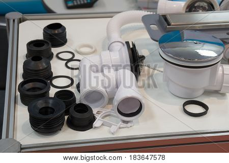 Plastic plumbing pipes and rubber fittings for sewage system on the table