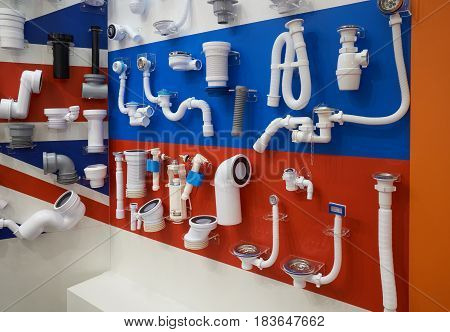 Plastic plumbing pipes and fittings for sewage system displayed in the store