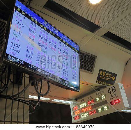 TAIPEI TAIWAN - DECEMBER 5, 2016: Timetable displays train schedule at Taipei Main railway station.