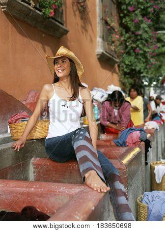 Hispanic woman doing laundry in public