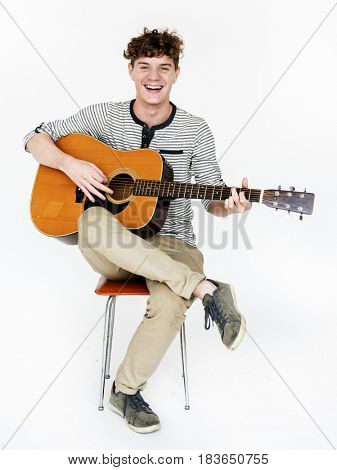 Man playing guitar relax and smiling