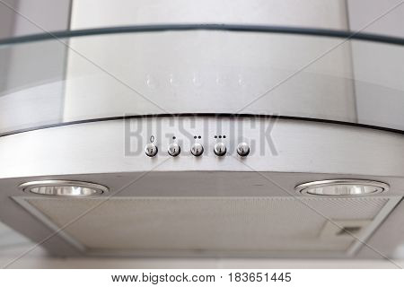 Controls of a white extractor hood close up