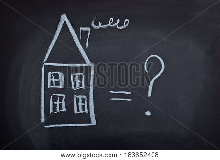 child's drawing with chalk on a school blackboard house and question mark