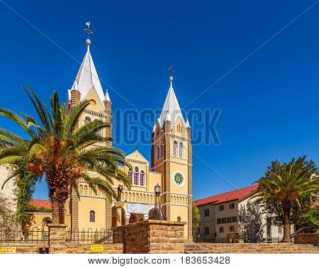 Catholic Saint Mary Church With Palms And Blue Sky  In Background, Windhoek, Namibia
