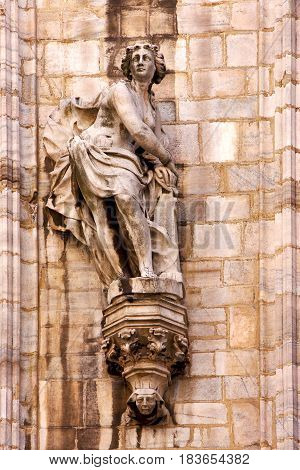 In Milan Italy Statue Of A Women In The Front Of The Duomo