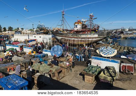 Essaouira Morocco - April 15 2015: People in the fishing harbour of Essaoira in the Atlantic Coast of Morocco Northern Africa.