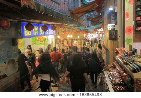 TAIPEI TAIWAN - DECEMBER 5, 2016: Unidentified people visit Jiufen old street market. Jiufen old street market. Famous film City of Sadness was filmed in Jiufen.