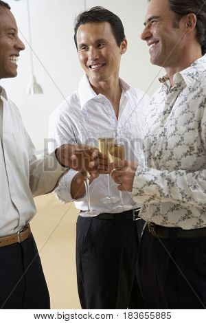 Friends celebrating with Champagne together