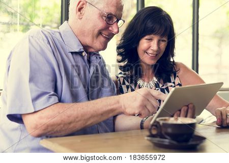 Couple using tablet browsing together