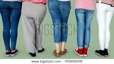 Group of human leg standing in a row in rear view