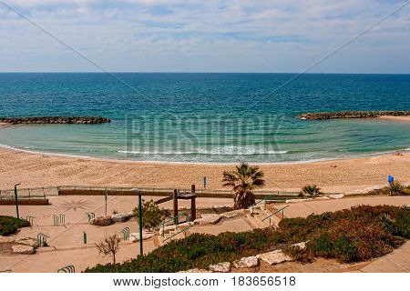 Sunny Mediterranean coastline with blue sky and some clouds