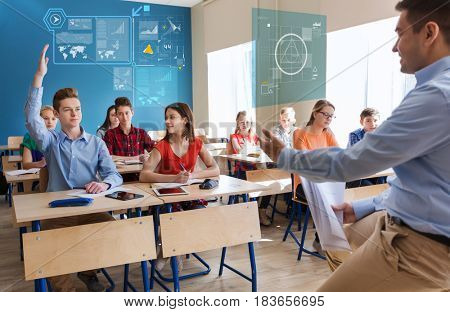 education, school, statistics and people concept - group of happy students and teacher with papers or tests over virtual screens with charts