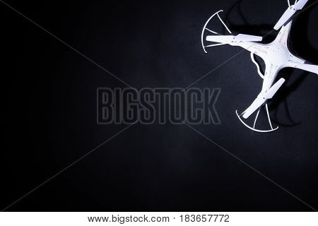 Photo Of White Quadrocopter On Black Background