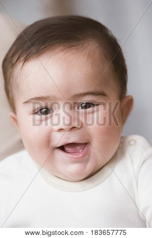 Hispanic baby boy smiling