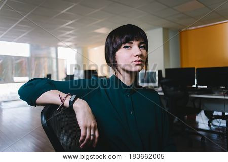 Young beautiful business woman smiling on the background jobs. The girl enjoy her office work. Office life