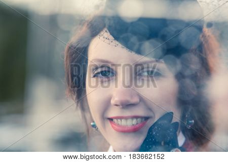 Portrait of a woman. Droplet effect on glass.